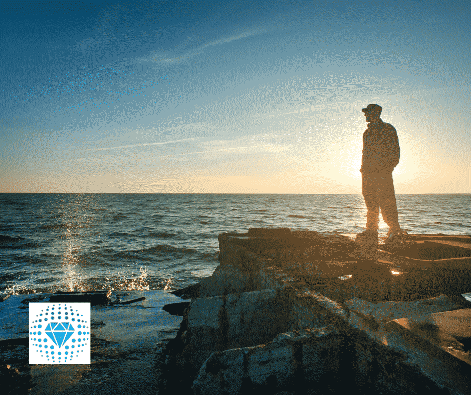 man looking over ocean, thinking