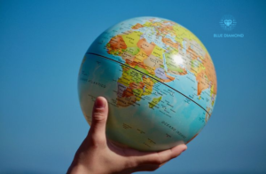 hand holding a globe to signify confidence