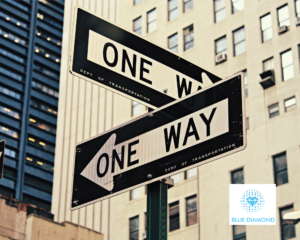 Two 'one way' signs pointing in opposite directions - looking for next role