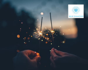 Sparklers lit and bright with sparks flying to symbolise sparks of ideas with blue diamond logo